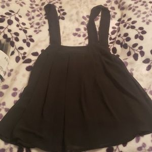 Dresses & Skirts - Skirt with straps.